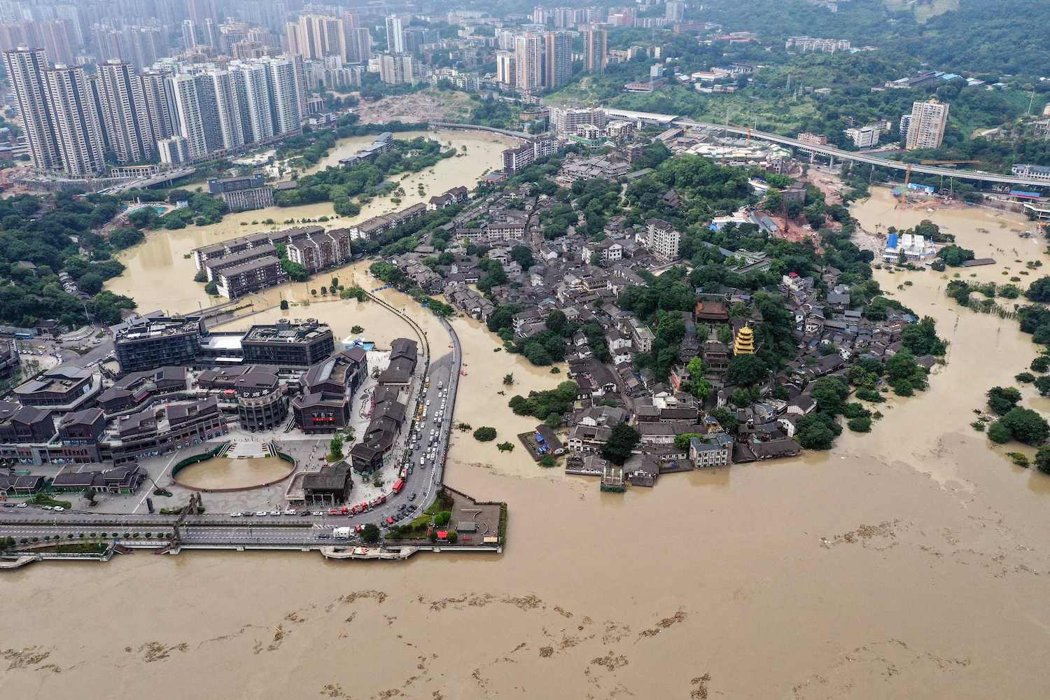 An aerial photo taken on Wednesday shows a flooded area in Chongqing in southwestern China. Floods have washed away roads and forced tens of thousands from their homes, with authorities warning that the giant Three Gorges Dam is facing the largest flood peak in its history. (AFP Photo)