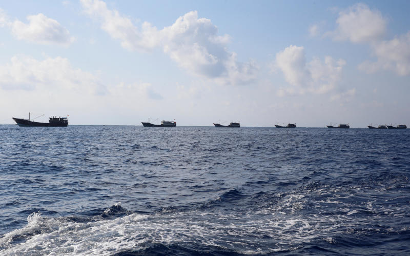 Chinese boats fish at the disputed Scarborough Shoal April 5, 2017. (Reuters file photo)