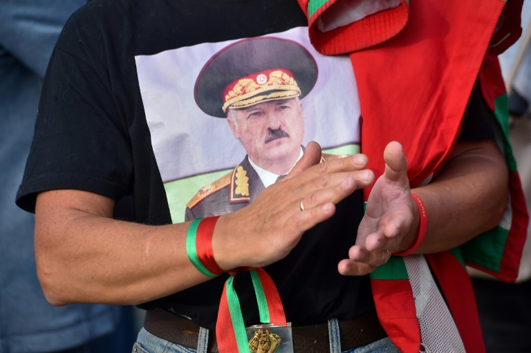 Videos show Belarus president armed with rifle as massive protests roil capital