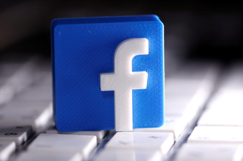 A 3D-printed Facebook logo is seen on a keyboard in this illustration taken March 25, 2020. (Reuters file photo)