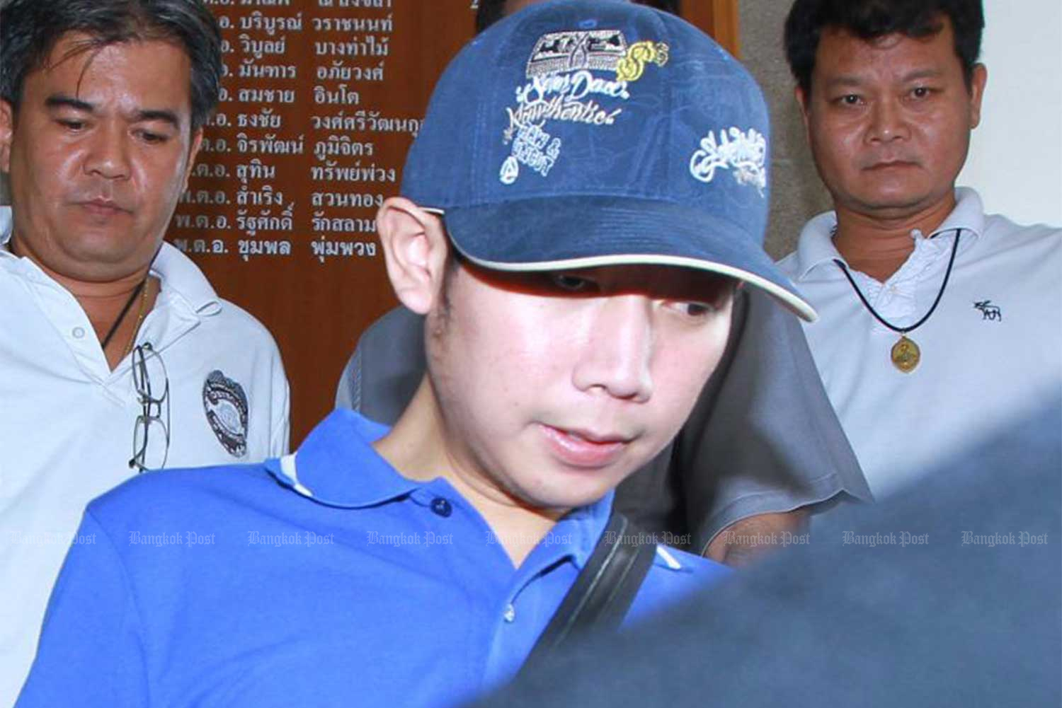 Police escort Vorayuth Yoovidhya in Bangkok after his hit-and-run case on Sept 3, 2012. (Bangkok Post file photo)