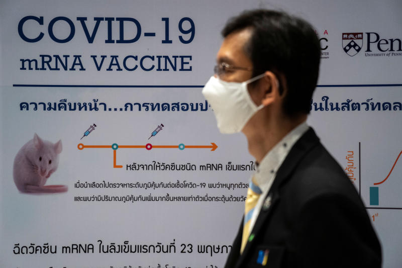 FILE PHOTO: A man wearing a face mask stands next to a board showing the progress of developing an mRNA type vaccine candidate for the coronavirus disease (Covid-19) during a news conference at the National Primate Research Center of Chulalongkorn University in Saraburi province, June 22, 2020. (Reuters file photo)