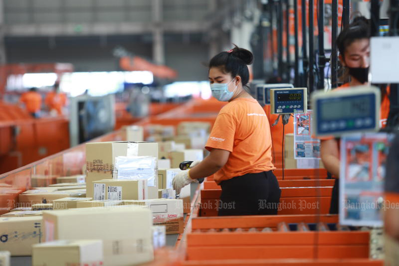 A distribution centre at parcel delivery service Kerry Express in Bang Phli district of Samut Prakan faces a considerable spike in volume. (Photo by Somchai Poomlard)