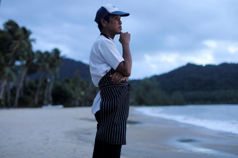 A chef stands on an empty beach as he waits for the costumers on Koh Chang in Trat on July 31, 2020. (Reuters photo)