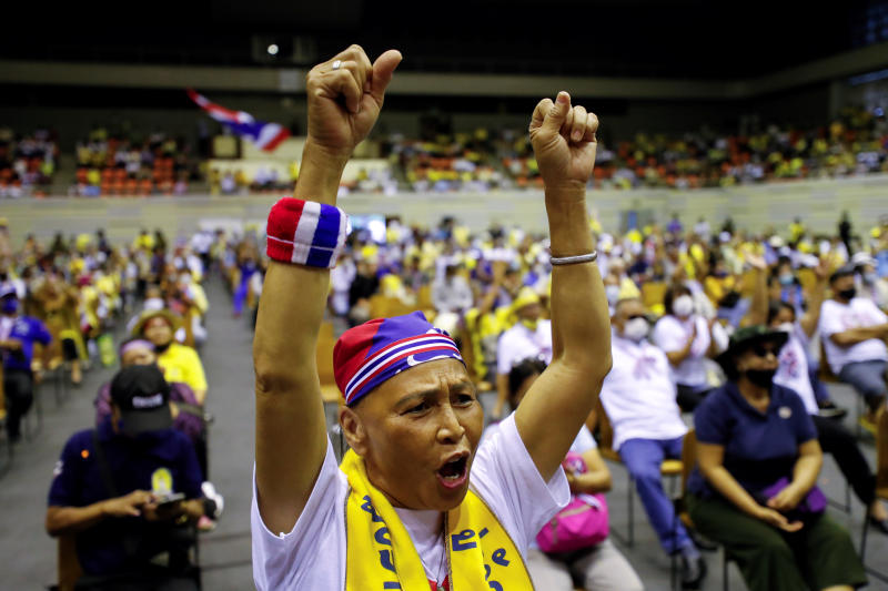 A person wearing a headband in Thailand's national colours reacts as members of right-wing group