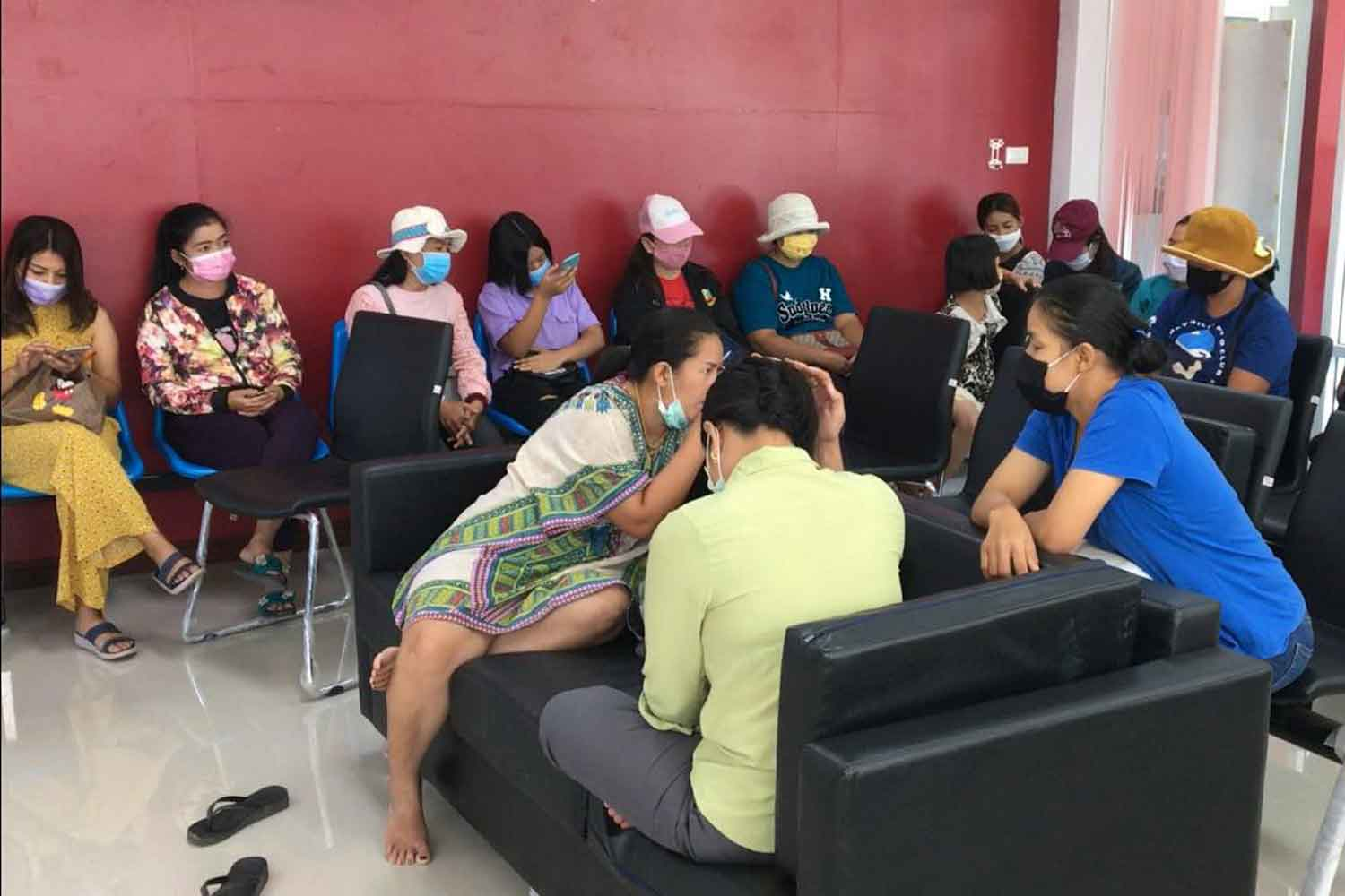 A group of women whose pictures were used to offer sexual services file complaints with police at the Chai Buri station in Chai Buri district, Surat Thani, on Sunday. (Photo: Supapong Chaolan)