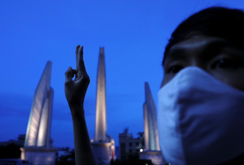 A pro-democracy student participates in a three-fingers salute marathon from 8am to 8pm during a rally near the Democracy Monument in Bangkok on Monday. (Reuters photo)