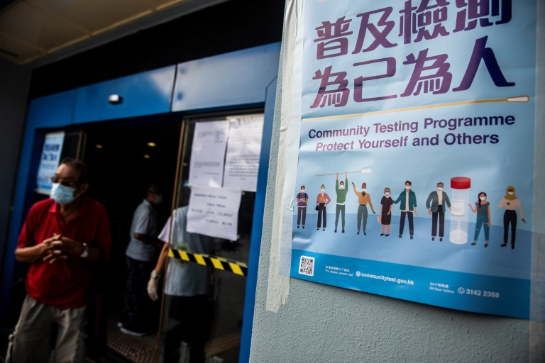 People wait at a Covid-19 coronavirus testing centre in Hong Kong.