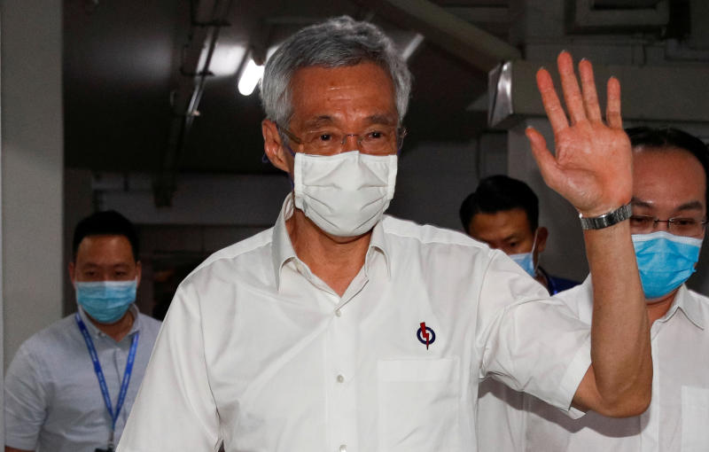 Singapore's Prime Minister Lee Hsien Loong waves as he arrives at a People's Action Party branch office, as ballots are being counted during the general election, in Singapore July 11, 2020. (Reuters file photo)