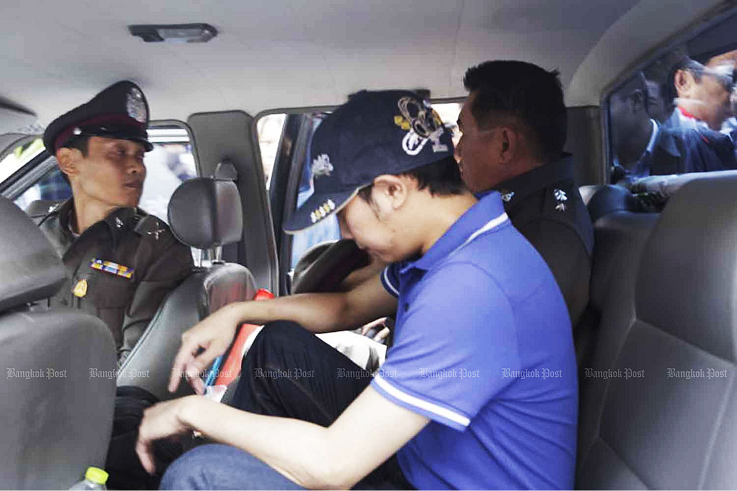 Police escort Vorayuth Yoovidhya in Bangkok after his hit-and-run on Sept 3, 2012. (Photo by Kosol Nakachol)