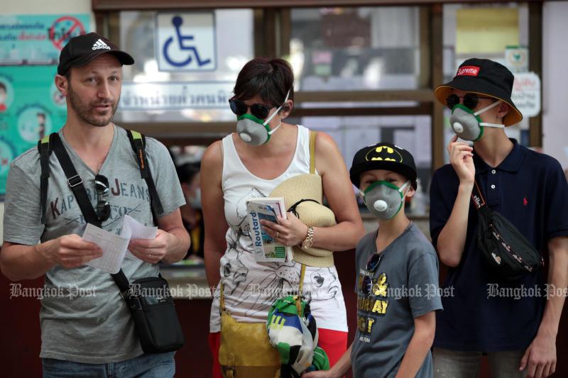 Tourists wearing face masks are seen at Hua Lamphong station on March 5, 2020. (Photo: Chanat Katanyu)