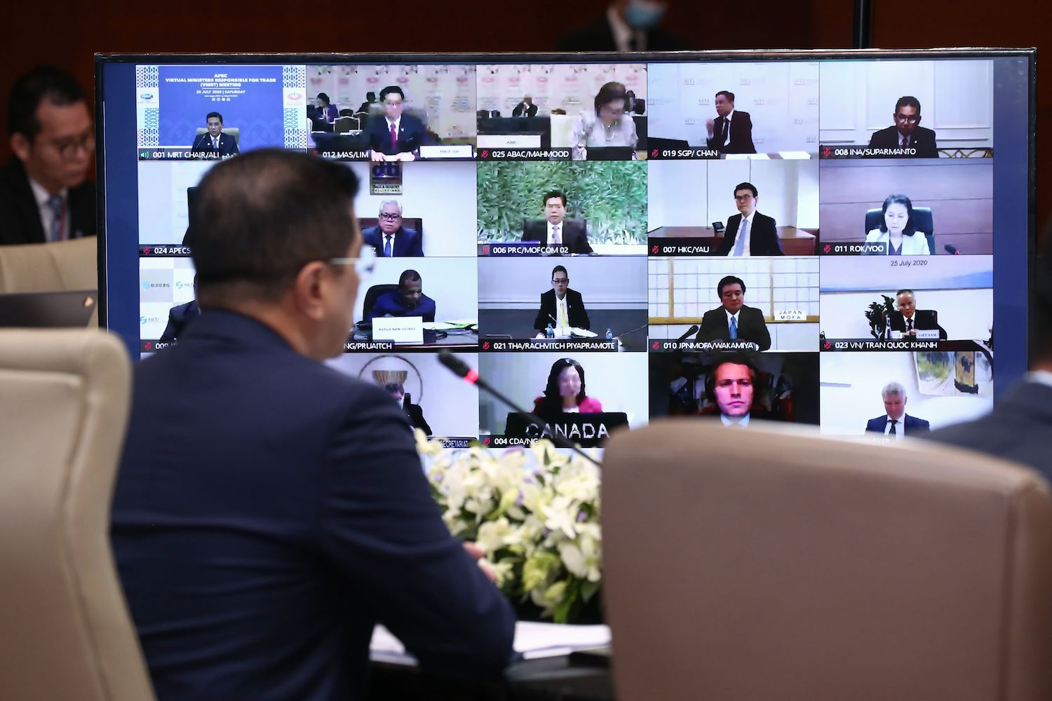 Mohamed Azmin Ali, Malaysia's minister of international trade and industry, interacts with his peers during an Apec trade ministers' meeting in July. The leaders' meeting will also be virtual, sources say. (Handout photo via AFP)