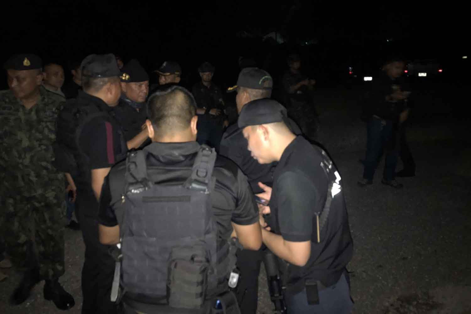 Members of a combined government force in a briefing session before being deployed to intercept suspected insurgents in Chana and Thepha districts in Songkhla province on Sunday night. Two suspected insurgents were killed in two clashes. ASSAWIN PAKKAWAN