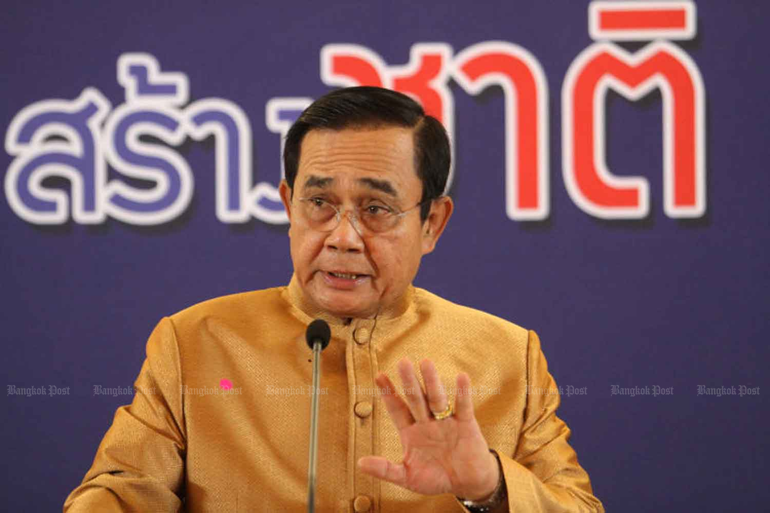 Prime Minister Prayut Chan-o-cha speaks to reporters at Government House after chairing a cabinet meeting on Tuesday. WICHAN CHAROENKIATPAKUL