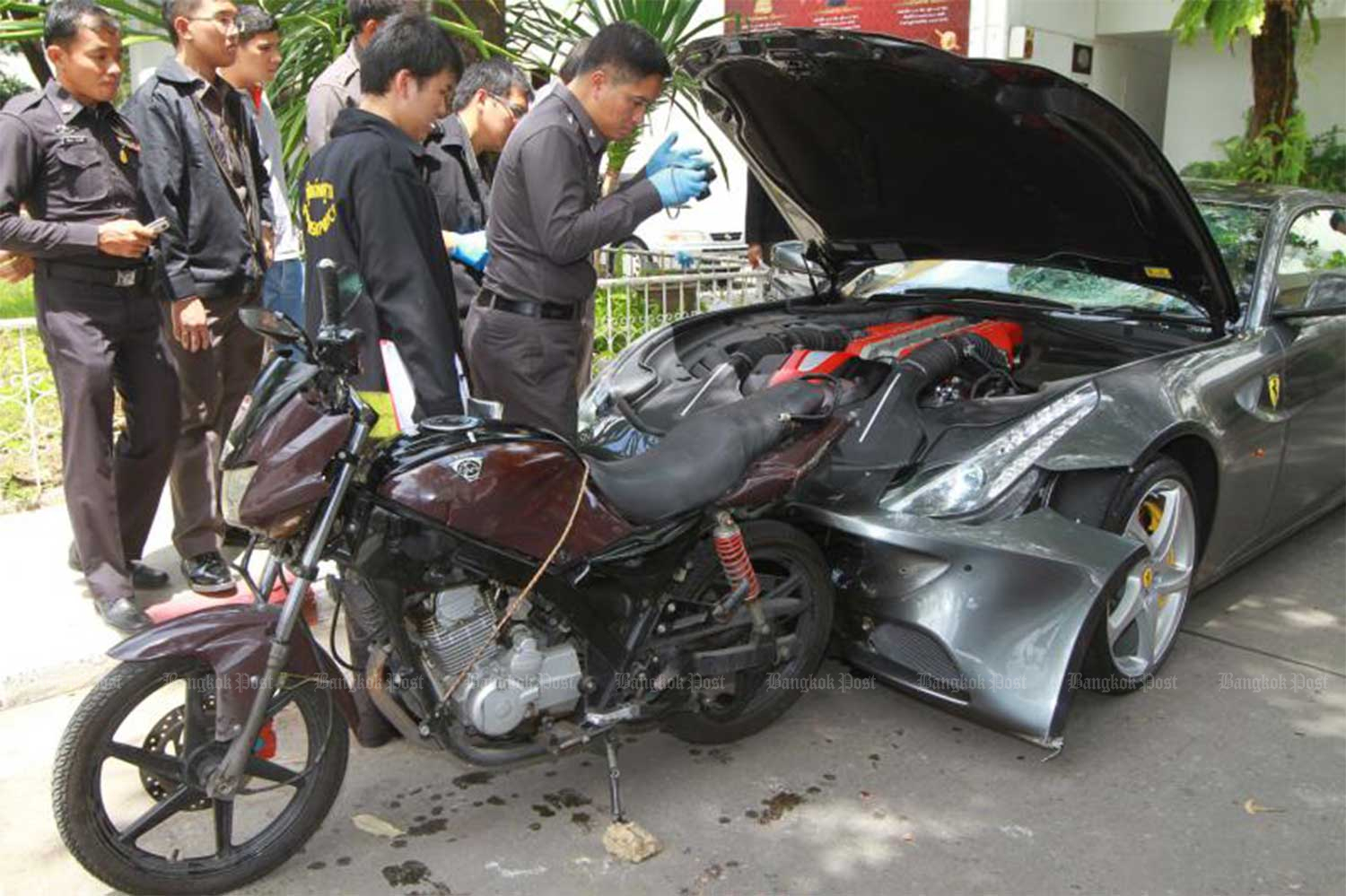 A file photo on Sept 4, 2012 shows Forensic police inspecting a motorcycle belonging to Pol Snr Sgt Maj Wichian Klanprasert of Thong Lor police station and a Ferrari driven by Vorayuth Yoovidhya, the youngest son of Red Bull executive Chalerm Yoovidhya, following the accident. (Photo: Somchai Poomlard)
