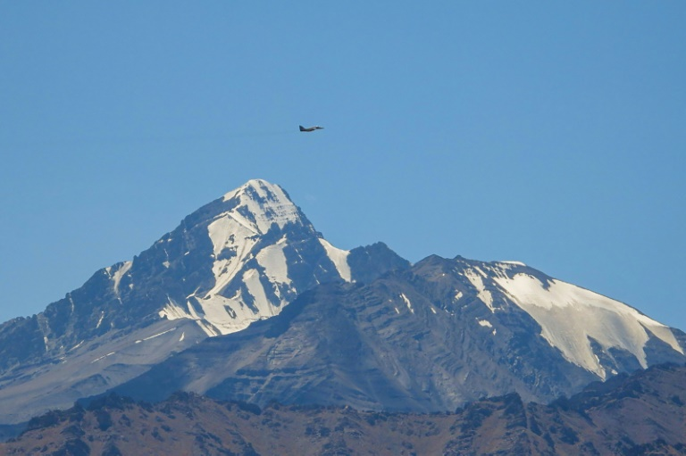 An Indian fighter flies over mountains near the border with China, where military tensions have escalated since clashes in June.