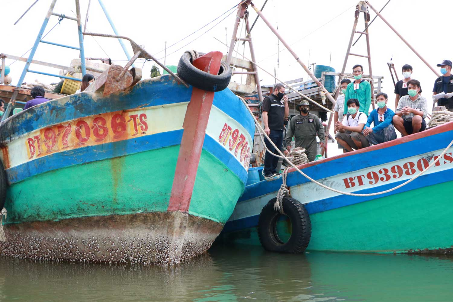 Two Vietnamese fishing boats are seized in Thai waters off Narathiwat province on Wednesday. (Photo by Waedao Harai)