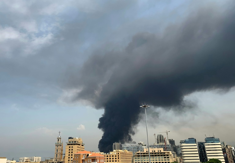 A huge column of black smoke billows into the sky over Beirut as the city's port is again engulfed by fire just weeks after a devastating dockside explosion