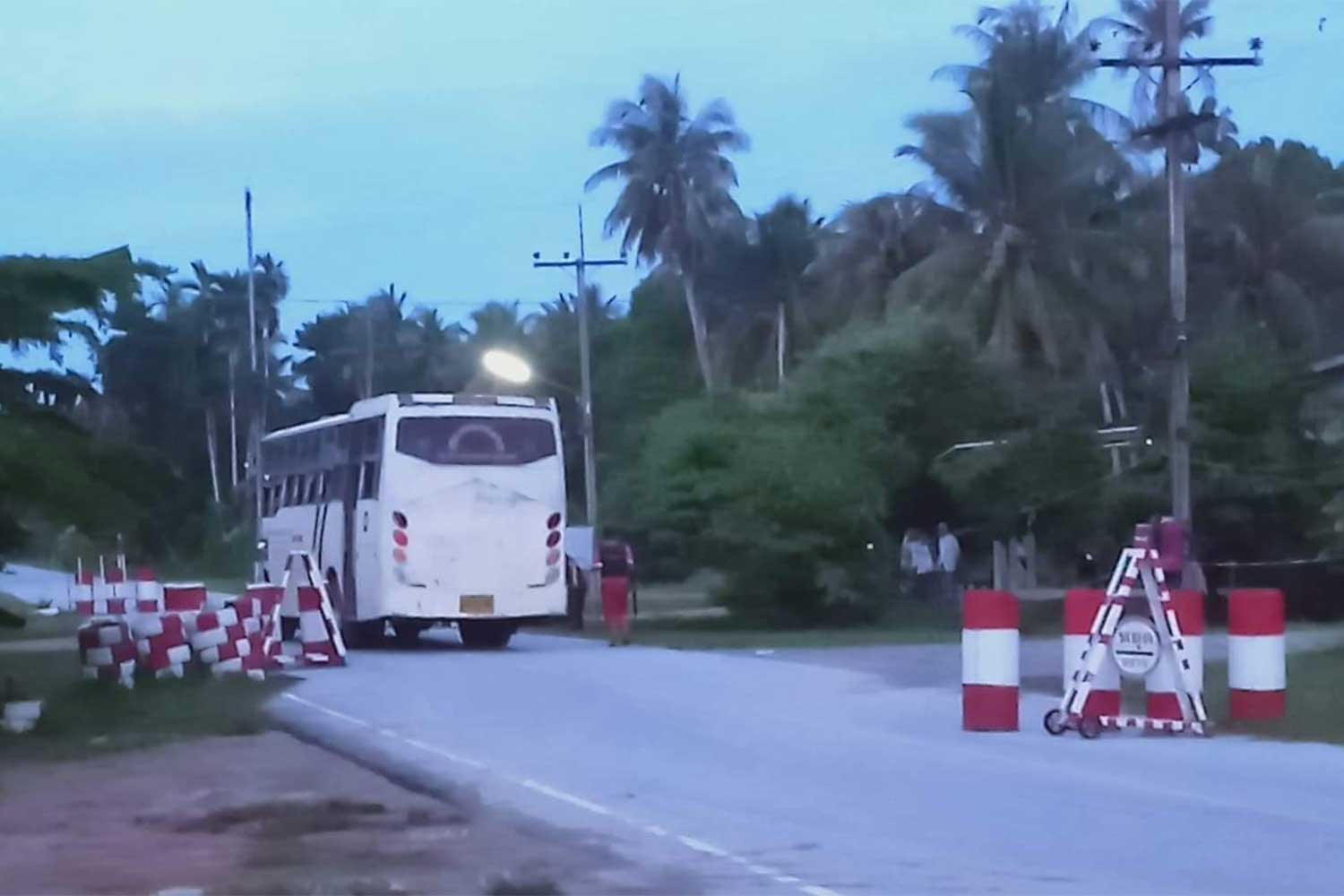 The school bus operated by a private Islamic school, parked at a military checkpoint in Yaring district, Pattani, after being hit by three shots fired by a ranger on Thursday evening. Nobody was injured. (Photo: Abdullah Benjakat)