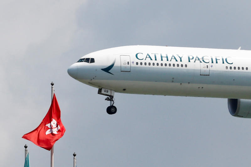 A Cathay Pacific Boeing 777-300ER plane lands at Hong Kong International Airport on Aug 14, 2019. (Reuters photo)
