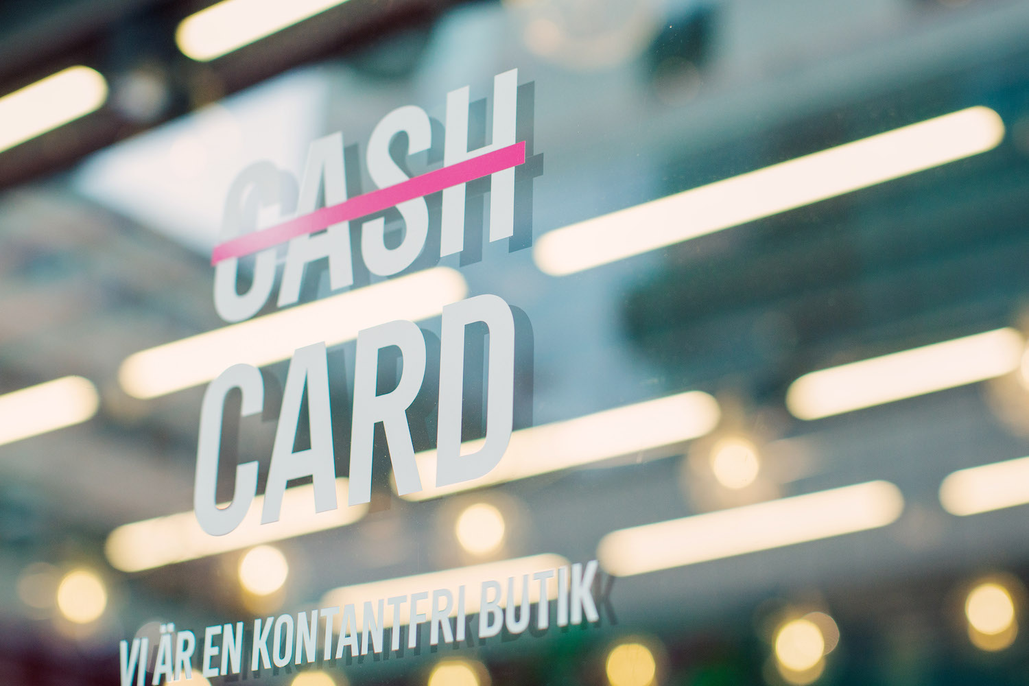 """A sign on a window of this Stockholm store translates as """"we are a cashless shop"""". (Bloomberg Photo)"""