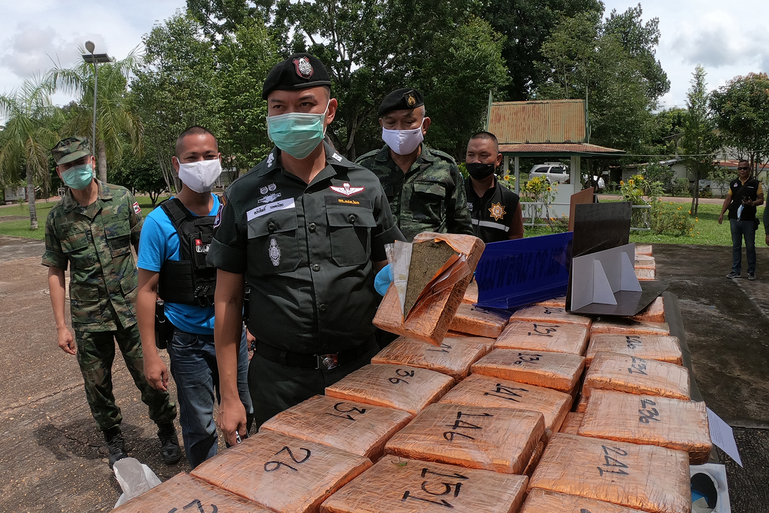 Pol Lt Col Apisit Rodnoy, chief of Border Patrol Police Company 237, shows seized dried marijuana during a press briefing in Muang district of Nakhon Phanom on Sunday. (Photo by Pattanapong Sripiachai)