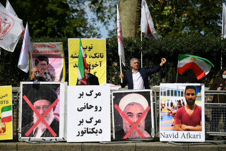 Protesters demonstrate outside the Iranian embassy in London on September 12, 2020 against the execution of Iranian wrestler Navid Afkari in the southern Iranian city of Shiraz and against the Iranian government