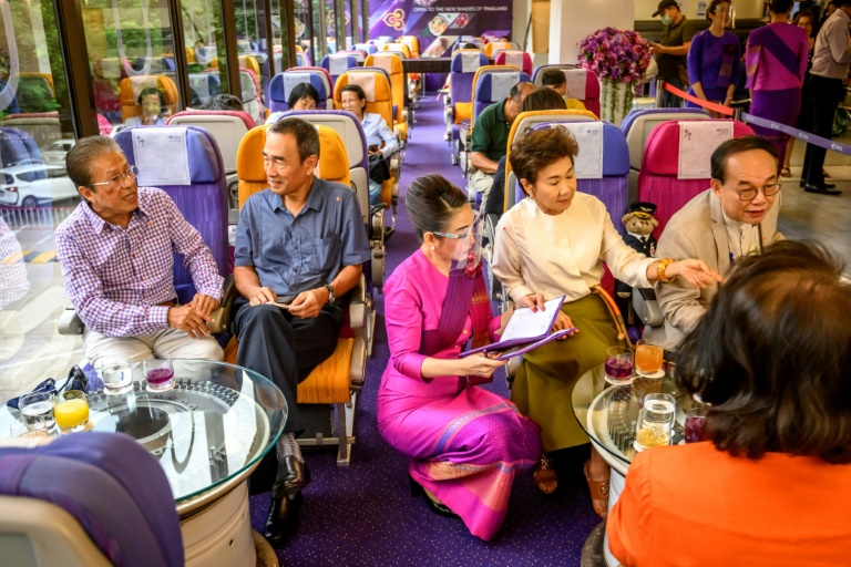 At the headquarters of Thai Airways in Bangkok, diners appear even to have missed plane food as they gobble up spaghetti carbonara served on plastic trays by cabin crew.