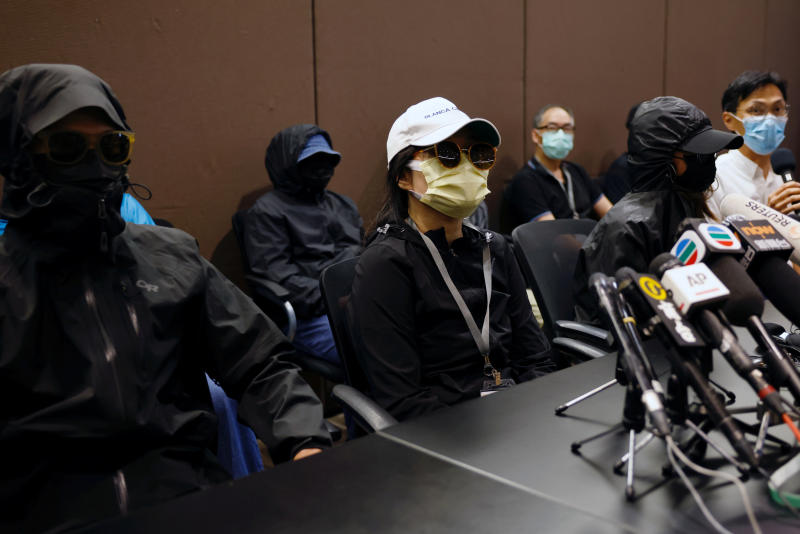 Family members of twelve Hong Kong activists, detained as they reportedly sailed to Taiwan to ask for political asylum, hold a news conference to seek help in Hong Kong on Saturday.