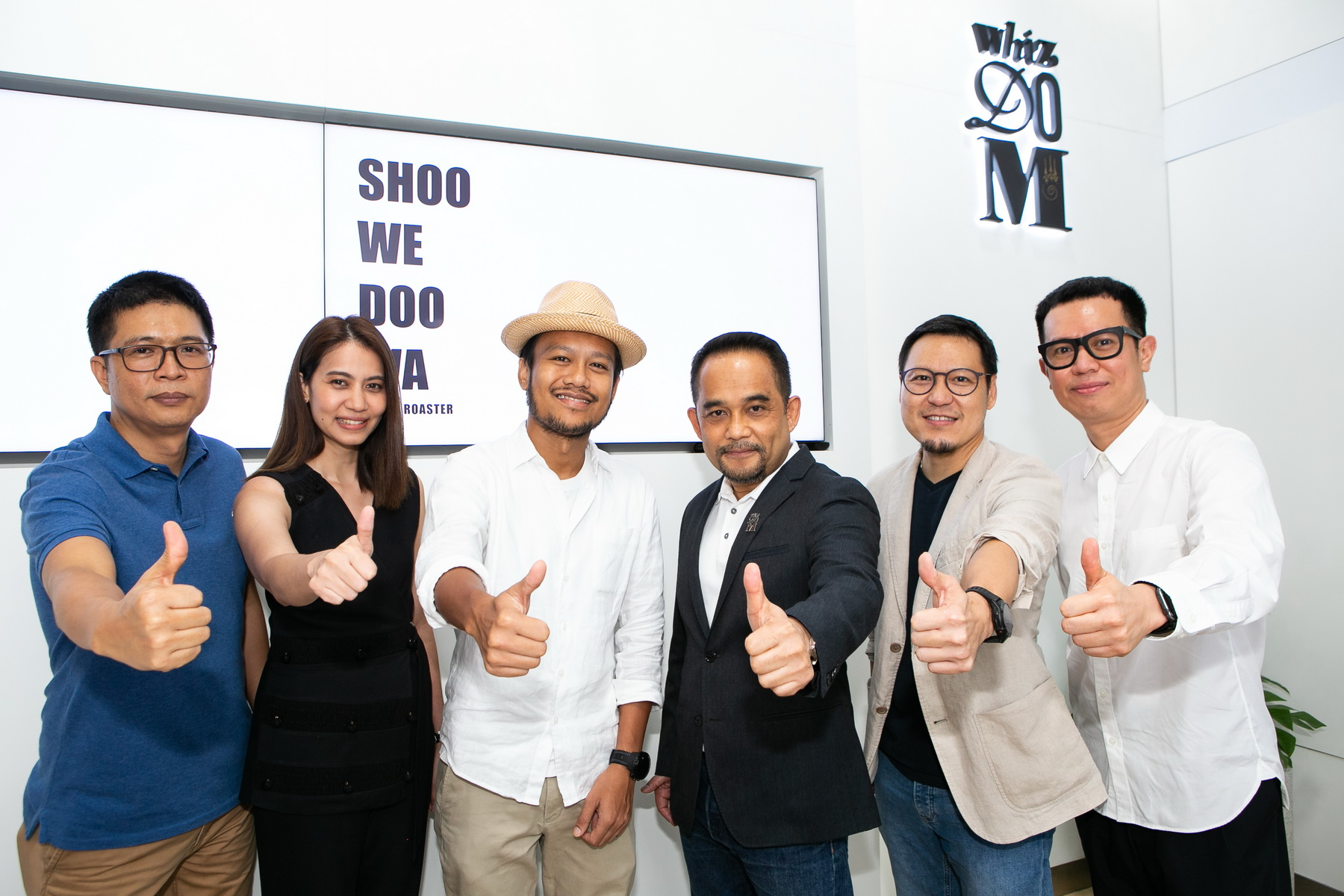 "From left: Mr. Pholsilp Boonmark, Senior Vice President of Project Development, MQDC, Ms. Ruedeekorn Onsawat, Vice President of Marketing and Branding, MQDC, Mr. Numchok Thanadram, Founder of the ""Shoo We Doo Wa"" coffee shop, Mr. Assada Kaeokhiao, President of MQDC's Whizdom brand, Mr. Anuwat Jiropaskosol, Vice President of Project Development, MQDC, and Mr. Athiwat Yowdhusit, Vice President of Marketing and Branding, MQDC."