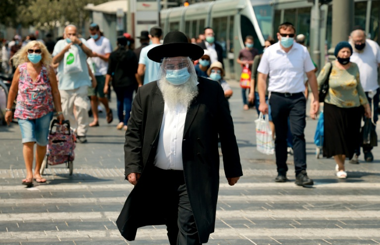 According to an AFP tally, Israel is second only to Bahrain for the world's highest coronavirus infection rate by population.