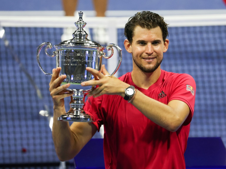 Dominic Thiem of Austria celebrates with the 2020 US Open trophy.