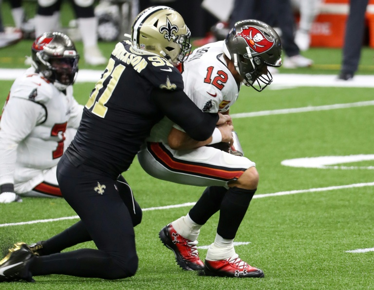 Tom Brady is sacked during a losing debut for the Tampa Bay Buccaneers against the New Orleans Saints.