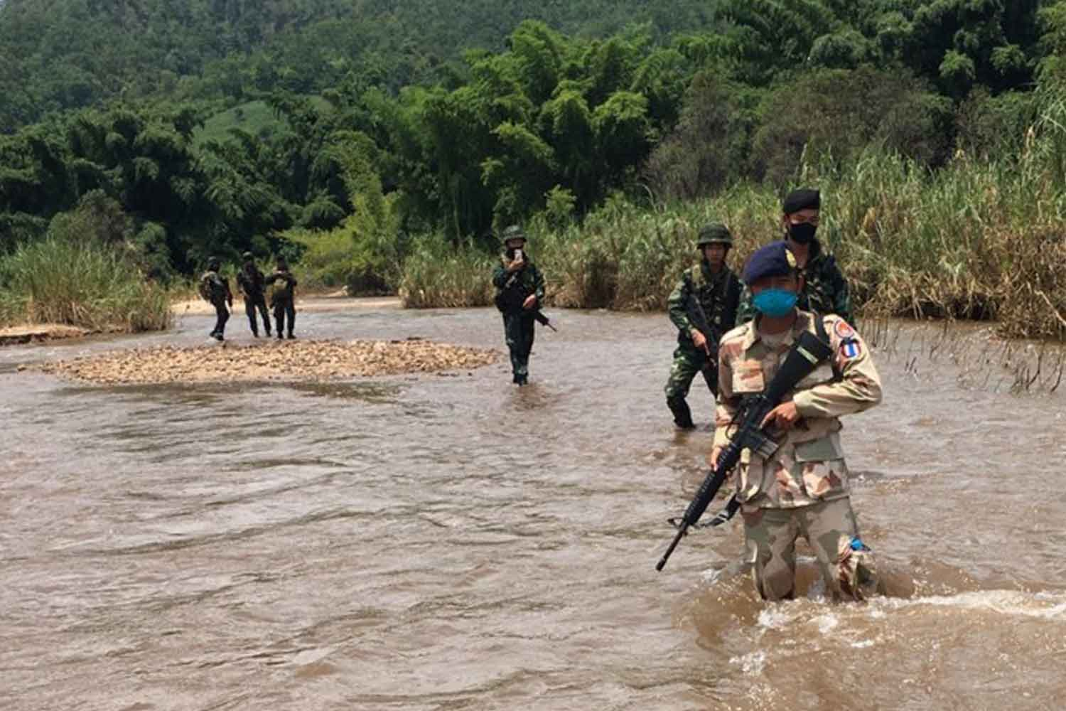 Thai security officials patrol the bordering Moei River in Mae Sot district, Tak province, in a bid to block illegal migrants from Myanmar after the neighbouring country was hit by a new wave of Covid-19 infections. (Photo supplied by Assawin Pinitwong)
