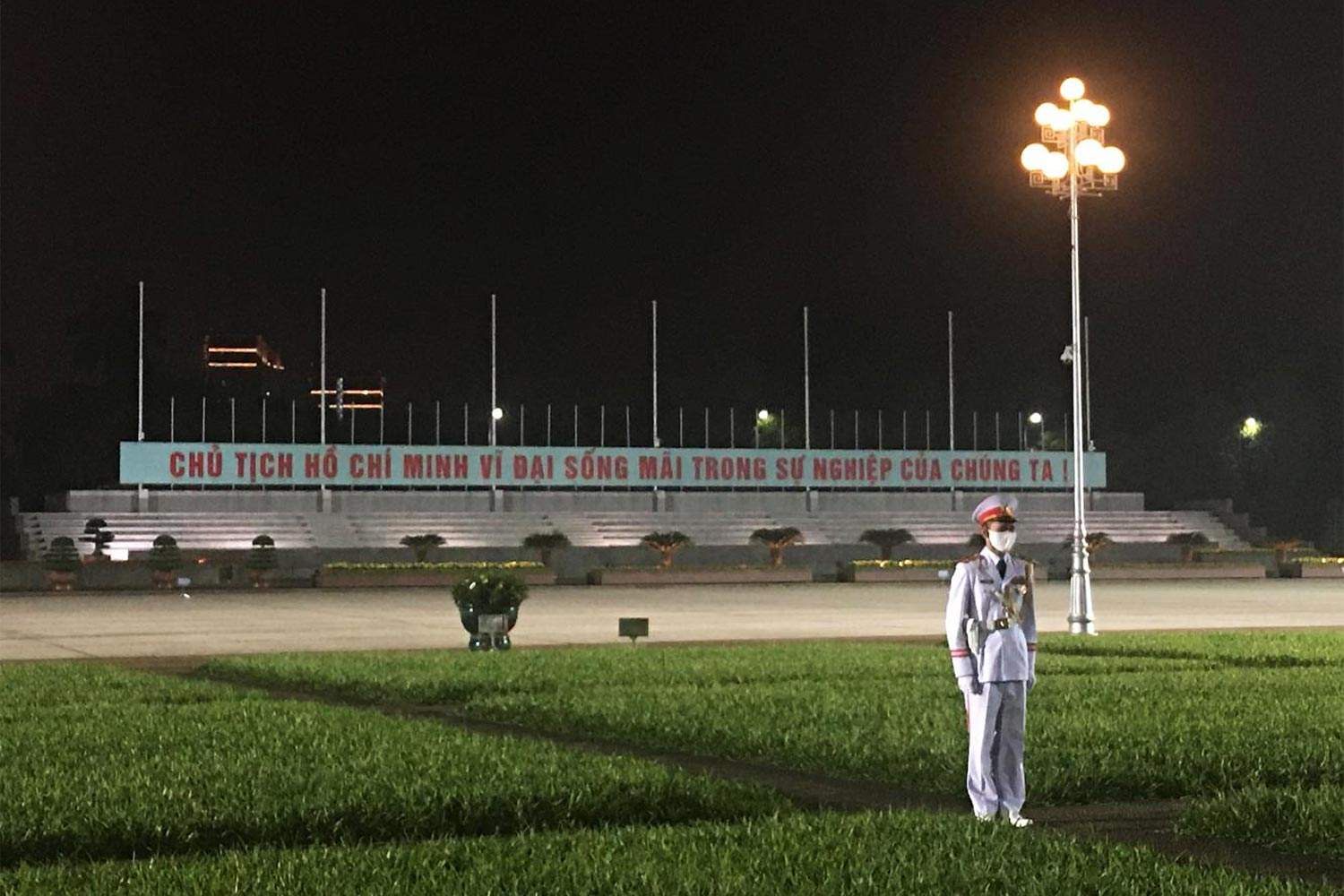 A masked sentry stands guard outside the Ho Chi Minh Mausoleum in Ba Dinh Square, Hanoi in March. (Photo: Uyen Diep)