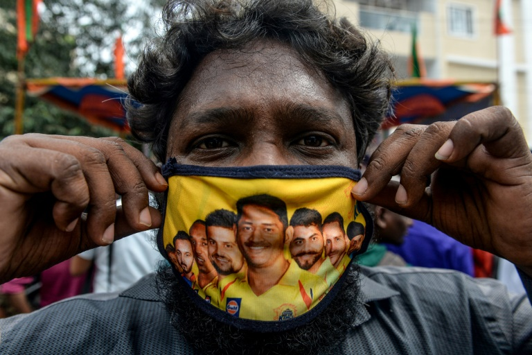 This fan in Chennai has a facemask decorated with pictures of Chennai Super Kings players