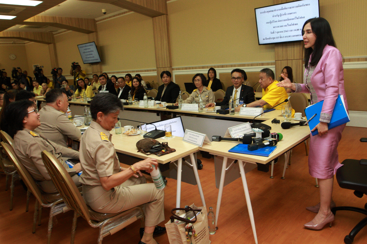 Deputy Agriculture Minister Mananya Thaiset chats with officials before chairing a meeting of the National Hazardous Substances Committee in October last year. (Post File Photo)