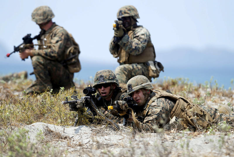 FILE PHOTO: US military forces take up positions during the annual