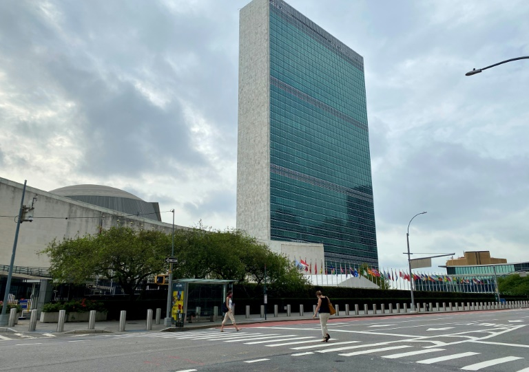 People walk on an empty First Avenue near the United Nations headquarters in New York on September 9, 2020.