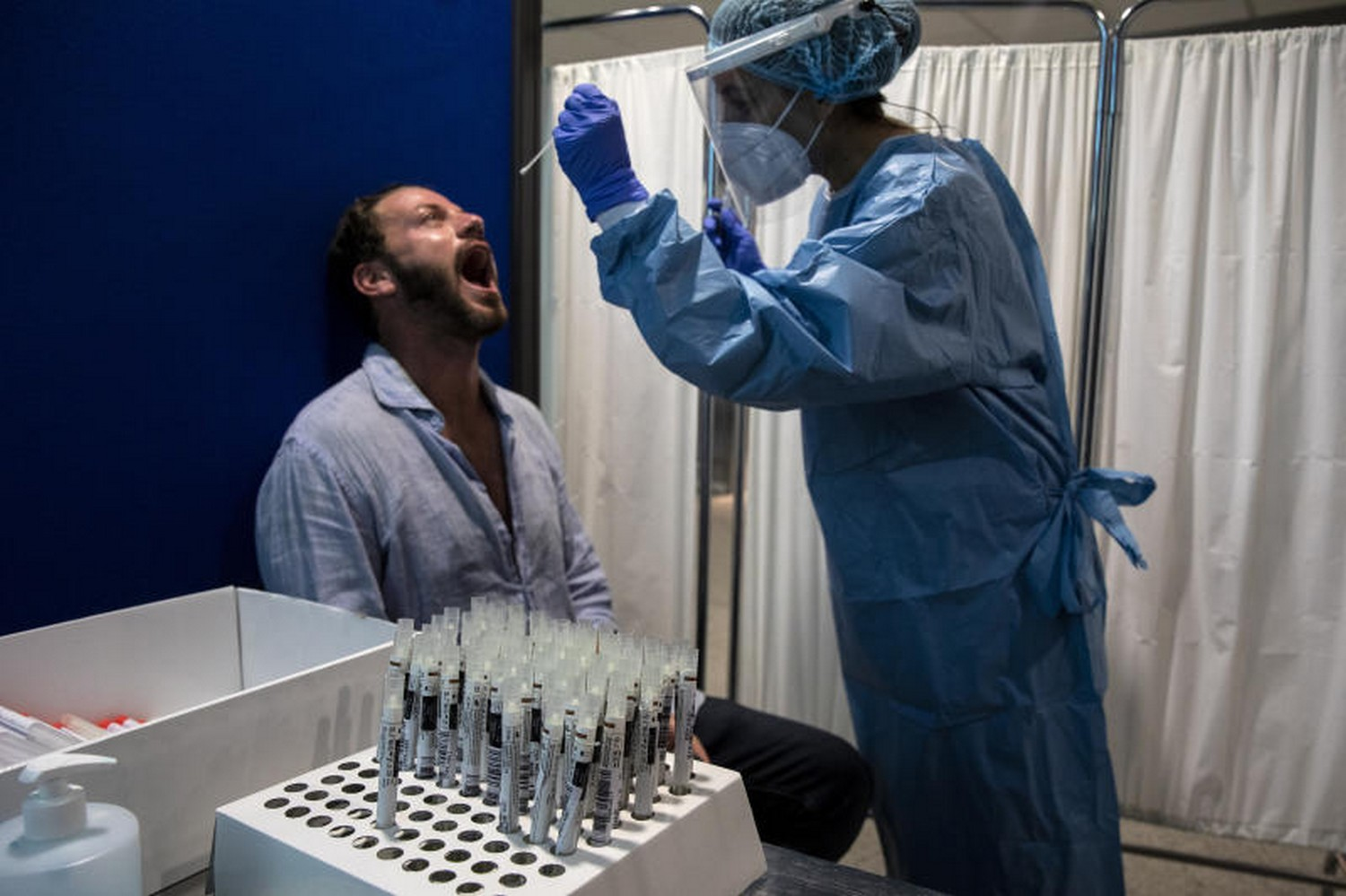 A medic performs a swab test on a traveller at a Covid-19 test centre inside Athens International Airport, Greece, on Sept 17 (Photo: Bloomberg)