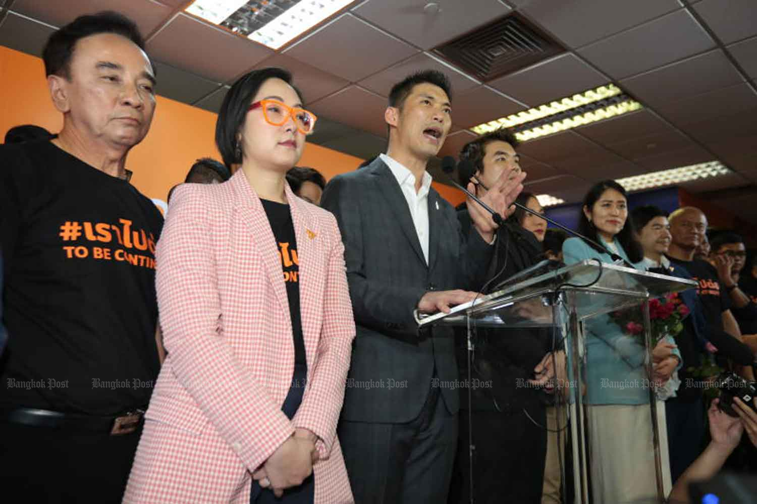Thanathorn Juangroongruangkit, third from left, leader of the disbanded Future Forward Party, addresses supporters on Feb 21 following the Constitutional Court's ruling which dissolved the party over a 191 million baht loan it accepted from him. (Photo: Chanat Katanyu)