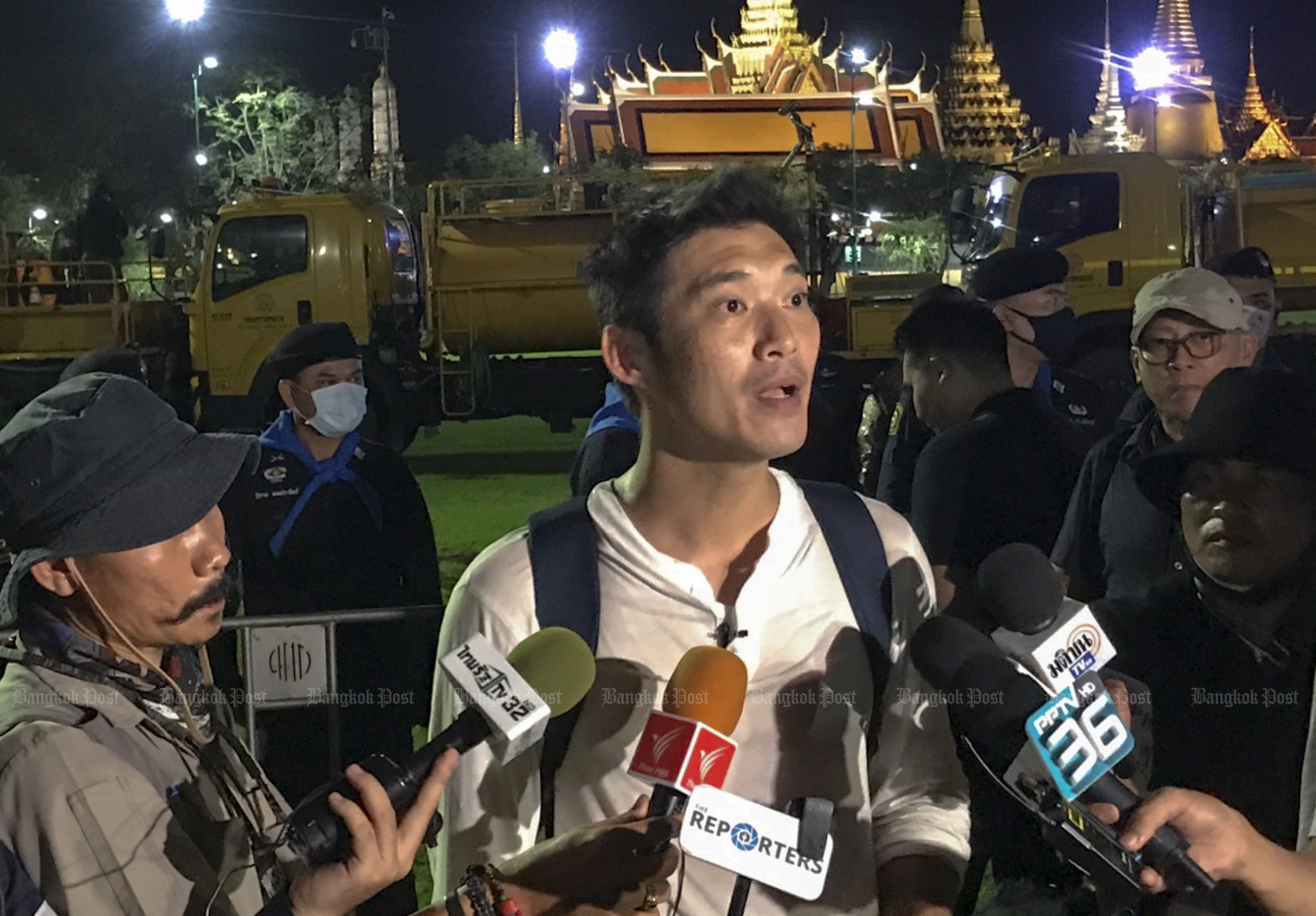 Progressive Movement co-founder Thanathorn Juangroongruangkit speaks to reporters during a brief appearance at the Sanam Luang pro-democracy protest on Sept 19. (Post File Photo).