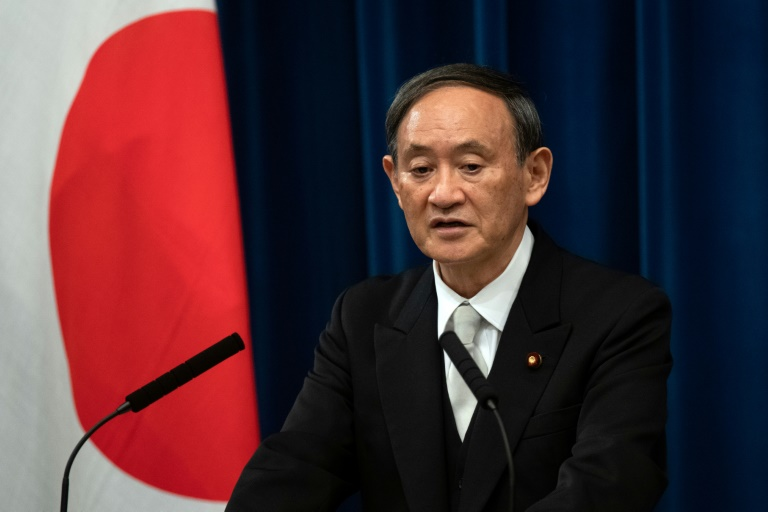 Japan's new Prime Minister Yoshihide Suga, seen here at his first press conference on September 16, 2020, has vowed to go ahead with the Olympic Games despite uncertainties over the coronavirus pandemic.