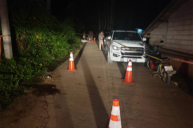 Police attend the scene where four people were shot dead at a wedding reception in Tham Phannara district of Nakhon Si Thammarat province on Saturday night. (Photo by Nujaree Raekrun)