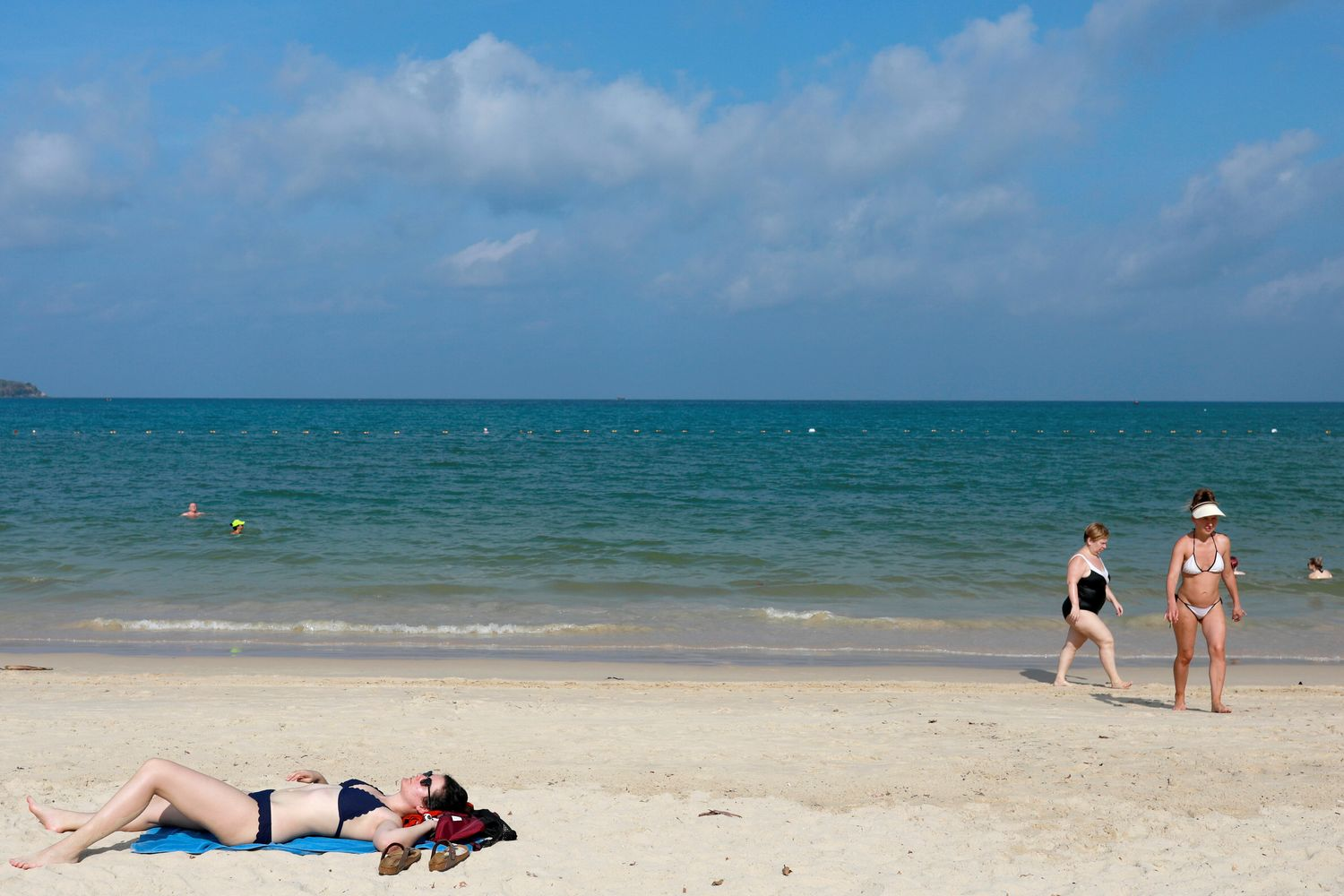 A few Western tourists are seen on a beach which is usually full of Chinese tourists, amid fear of coronavirus in Phuket on March 10. (Reuters photo)