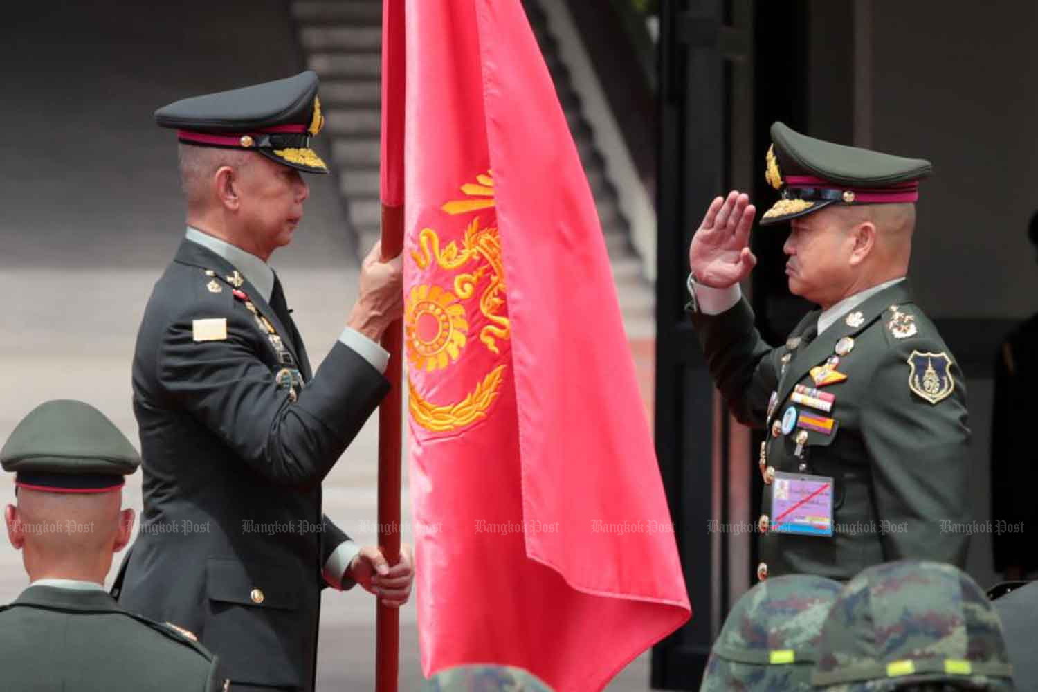 Outgoing army chief Apirat Kongsompong, left, hands over authority to his successor, Gen Narongphan Jitkaewtae, at the army headquarters. (Photo: Chanat Katanyu)