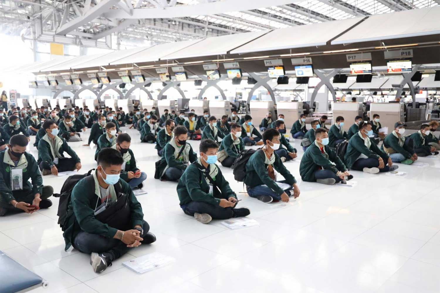 The 214 Thai workers gather at Suvarnabhumi airport on Wednesday before leaving for Israel to work in the agricultural sector. (Photo from @ThailandMOL Ministry of Labour Facebook page)