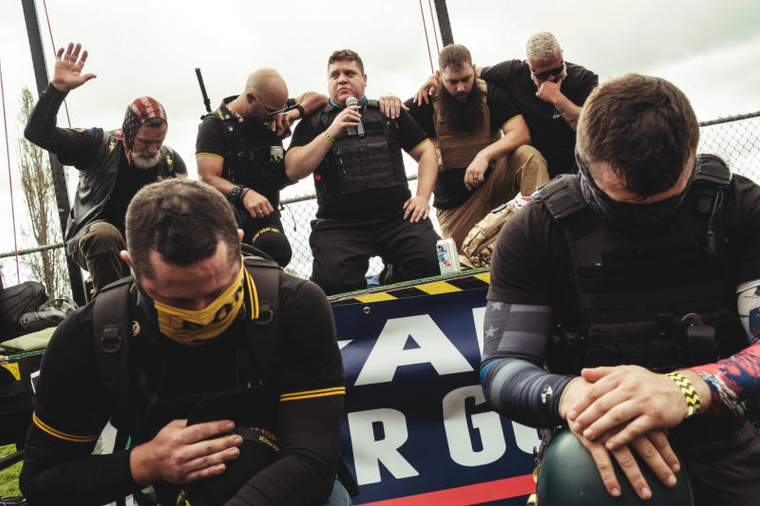 Members of the alt-right group, the Proud Boys, pray during a rally in Portland, Oregon, on Sept. 26 (Photo: New York Times)