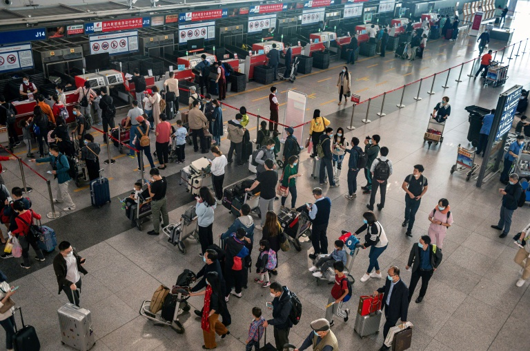 Hundreds of millions of people in China are hustling to take their first major holiday since the emergence of the coronavirus