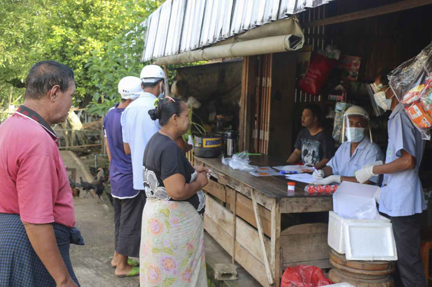 Health workers collect samples from people living near the Myanmar border in Sangkhlaburi district, Kanchanaburi, for Covid-19 testing, on Friday. (Photo: Piyarach Chongcharoen)